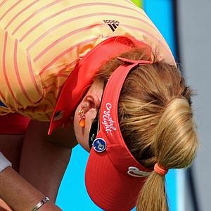 Paula Creamer grabs her injured thumb after hitting a shot at the Honda PTT LPGA Thailand.