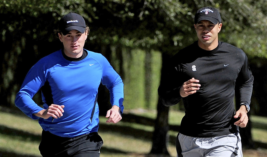Tiger Woods (right) jogs with an unidentified friend Feb. 17 near his home in Windermere, Fla.