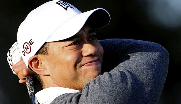 Tiger Woods practices golf outside his home Thursday in Windermere, Fla.