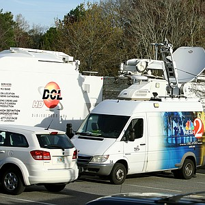 Satellite trucks gather outside the Sawgrass Marriott in Ponte Vedra Beach, Fla.