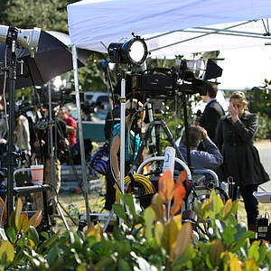 Media outlets, such as CNN with reporter Susan Candiotti (far right), conduct live shows outside the Sawgrass Marriott in Ponte Vedra Beach, Fla., prior to Tiger Woods' statement.