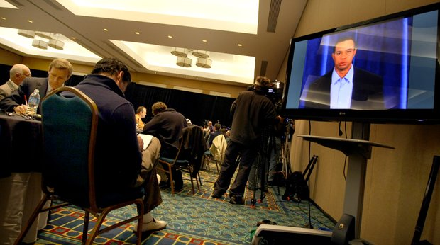 Media representatives from around the world gather around televisions in a hotel ballroom at Sawgrass Marriott in Ponte Vedra Beach, Fla., to watch Tiger Woods' make his first public statement in three months on the heels of his November 2009 SUV accident inside Isleworth. (Feb. 19, 2010)