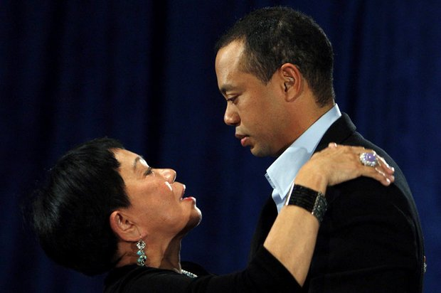 Tiger Woods hugs his mother, Kultida, after making his statement.