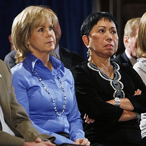 Kathy Battaglia, Kultida Woods and Amy Reynolds listen to Tiger Woods deliver his statement.