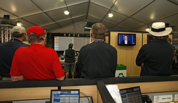 Tiger Woods appears on television screens in the press room at the Accenture Match Play Championship.