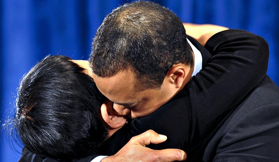 Tiger Woods and his mother, Kultida, hug after Tiger delivered a statement Friday.