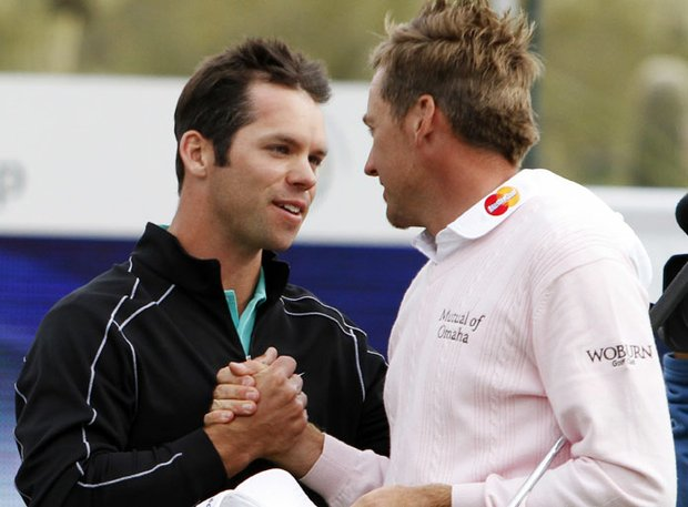 Paul Casey (left) congratulates fellow Englishman Ian Poulter after his victory in the finals of the Match Play Championship.