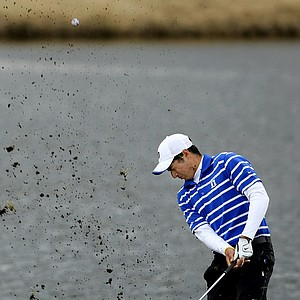 Duke's Julian Suri takes a face full of mud on his first attempt at hitting his plugged ball out of the bunker at No. 9.