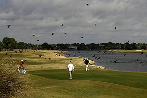 Mitchell Sutton, Adam West and Garrick Porteous putt at No. 18 during the 2010 John Hayt Invitational at Sawgrass Country Club.