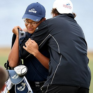 Joe Byun of University of North Florida gets a bear hug from teammate, J. C. Horne after leading his team to victory on Tuesday.