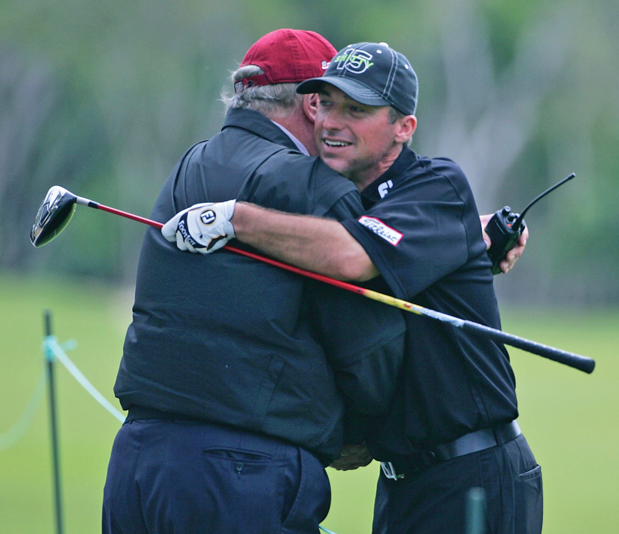 Chris Smith gets a greeting from PGA Tour rules official Michael Combs.