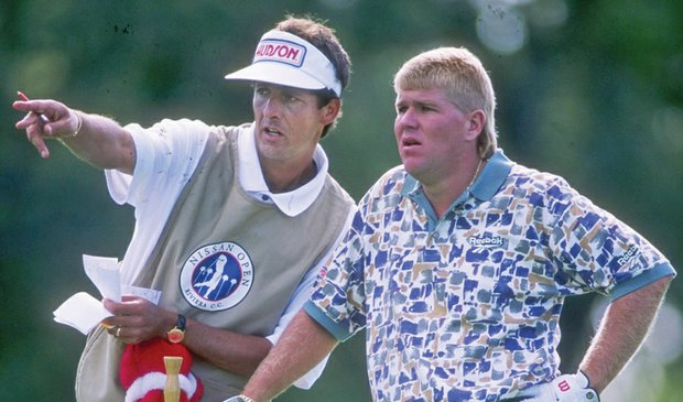 Greg Rita (left, shown in 1996) carried the bag for several major champions, including John Daly.