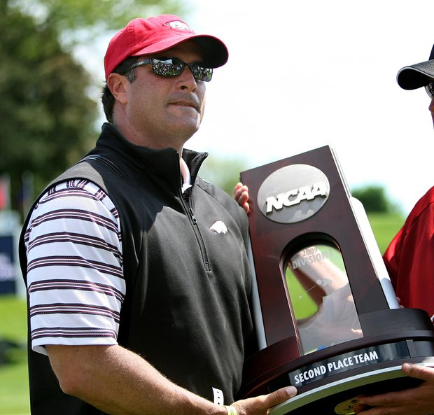 Arkansas coach Brad McMakin accepts the runner-up trophy at the 2009 NCAA Championship.