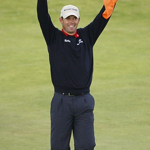 Padraig Harrington waves the Irish flag after winning the 2007 British Open.