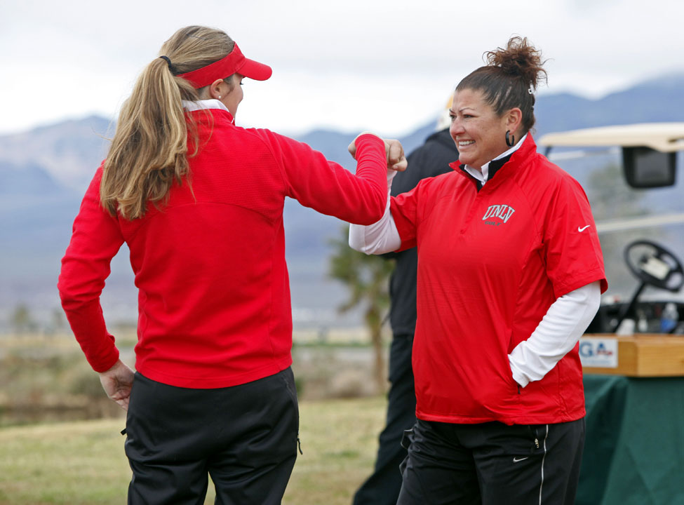 UNLV's Therese Koelbaek (left) shares a fist-bump with coach Missy Ringler.