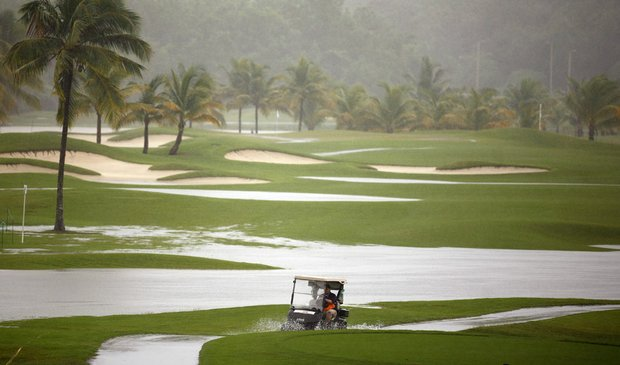 Only 18 players teed off Thursday at the Puerto Rico Open before rain pounded an already wet Trump International Golf Club and forced the postponement of the opening round.