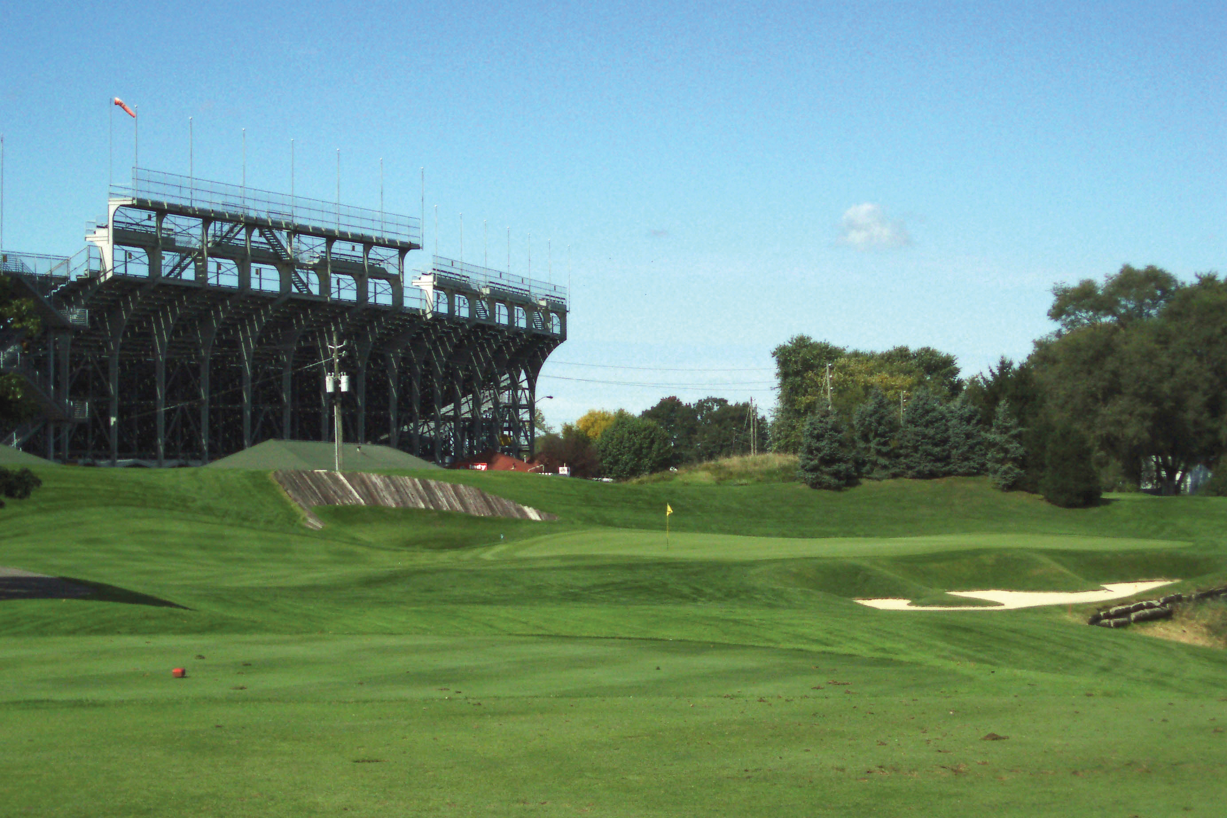 No. 13 at Brickyard Crossings with the Indianapolis Motor Speedway in the background.