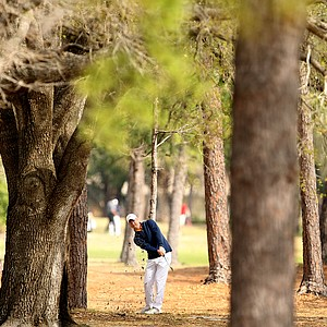 University of Toledo's Ben Boyer punches out of a line of trees at No. 18.