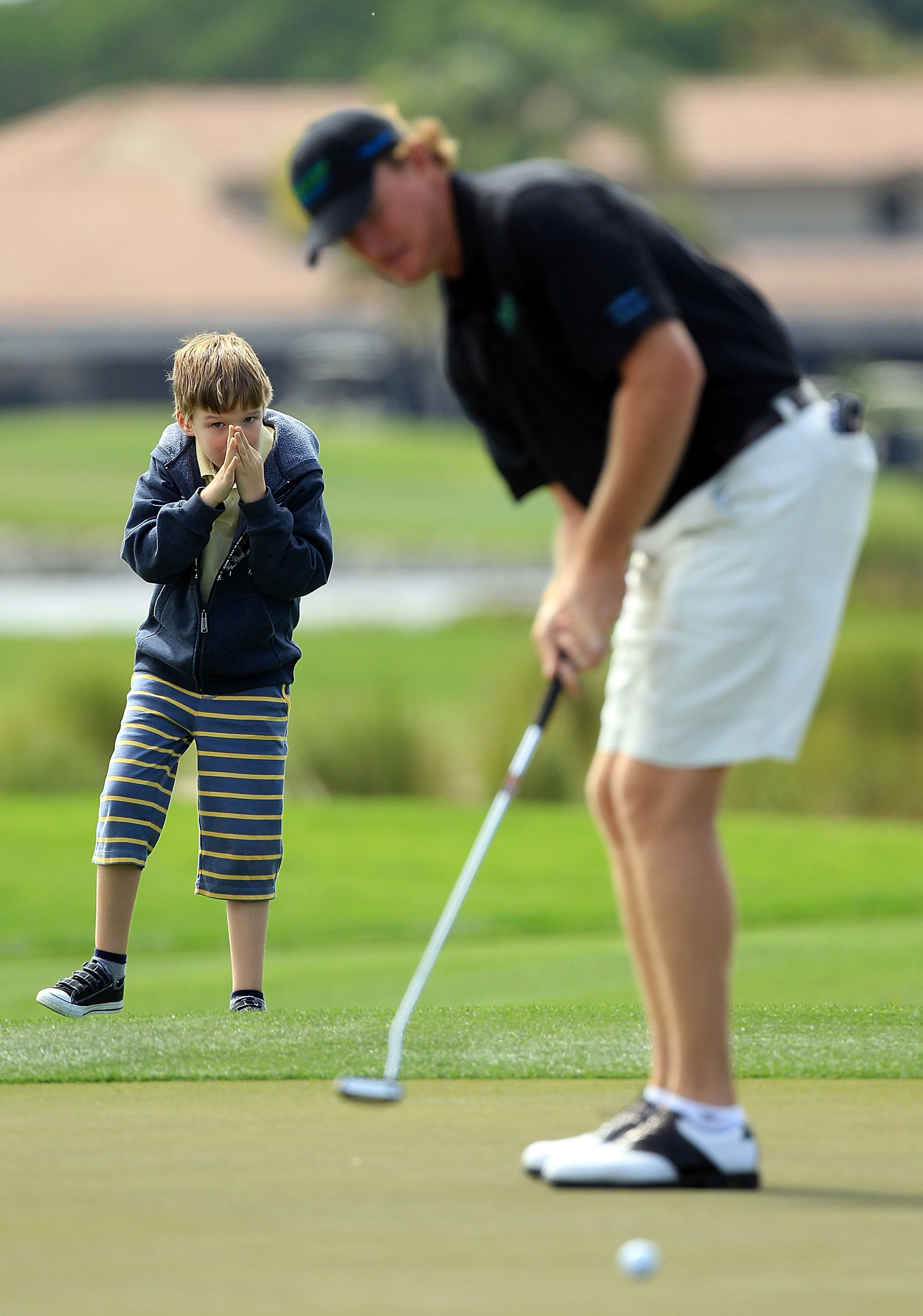 Ben Els watches his father Ernie putt during a pro-am at PGA National on March 15.