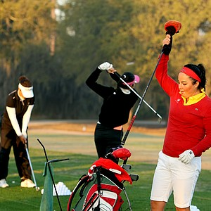 Lili Alvarez warms up on the driving range before her 8:15 tee time.