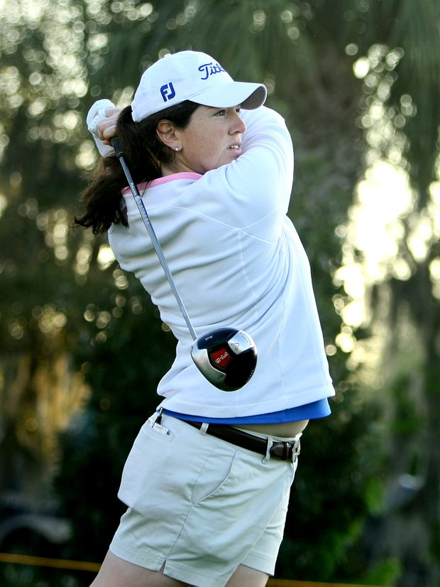 Former N. C. State player Lauren Doughtie watches her tee shot at No. 1.