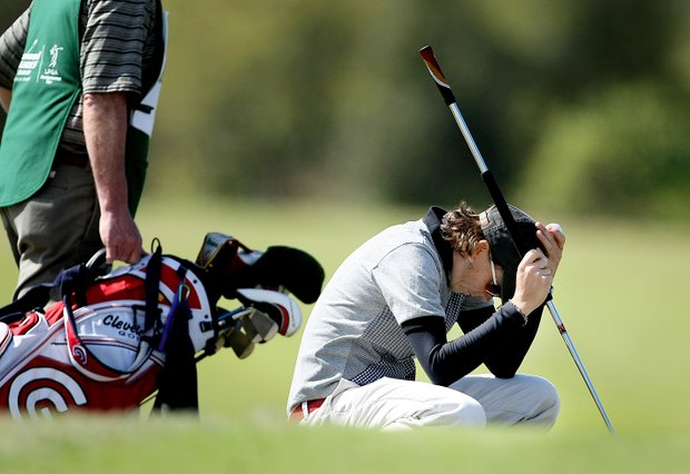 Libby Smith reacts to missing her putt at No. 9.