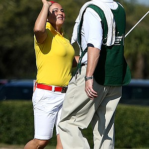 Lili Alvarez celebrates a chip-in birdie at No. 18 with her caddie, LPGA Commissioner Mike Whan.