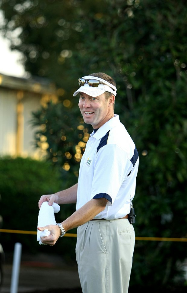 Mike Whan wets a towel at the Florida's Natural Charity Classic, where he caddied for Lili Alvarez.