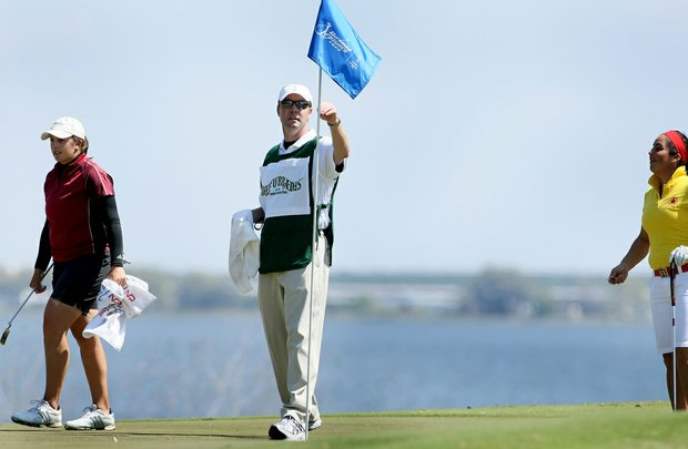 Mike Whan removes the pin at No. 3 during the Florida's Natural Charity Classic.
