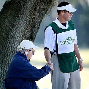 Mike Whan takes time out form his caddie duties to thank a volunteer at the Florida's Natural Charity Classic.