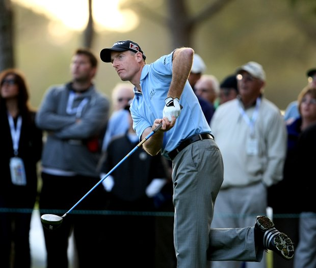 Jim Furyk reacts to his tee shot at No. 16.