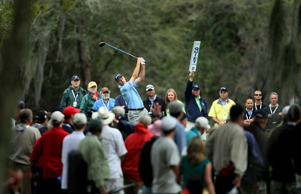 A crowd forms to watch Jim Furyk tee off at the ninth during the final round of the Transitions Championship.