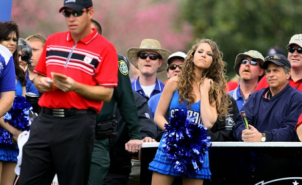 Team Isleworth's Brian Gay, an Orlando Magic cheerleader and Tavistock spectators watch the tee shot of Charles Howell III at No. 2 during the Tavistock Cup.
