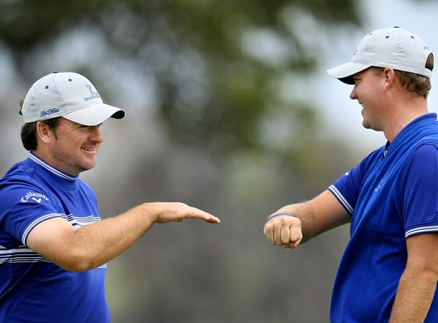 Team Nona's Graeme McDowell and Peter Hanson celebrate on the ninth hole during Monday's Tavistock Cup at Isleworth Golf and Country Club.
