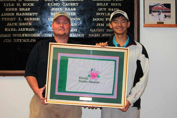 Shun Yat Hak accepts the Florida Azalea Amateur trophy.