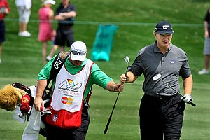 Ernie Els walks down the 8th fairway during the first round, he is tied for fifth.