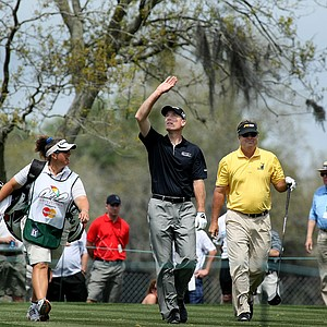 Jim Furyk looks up as he leavs the eighth tee with Kenny Perry, right, and Henrik Stenson's caddie Fanny Sunesson during the first round.
