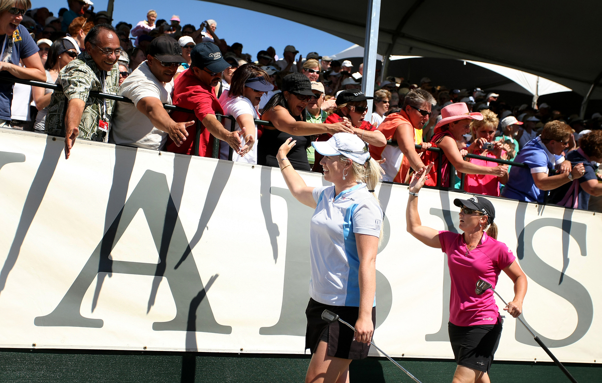 Brittany Lincicome (left) and Kristy McPherson walk to the 18th green during the final round of the 2009 Kraft Nabisco Championship.