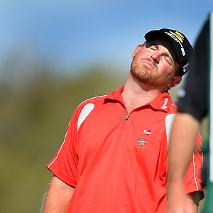 J. B. Holmes reacts to his putt at No. 14.