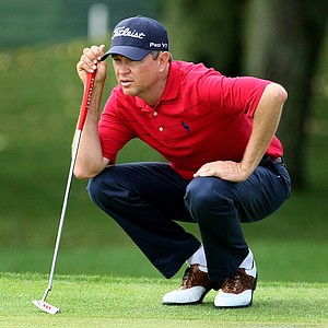 Davis Love III reads a putt on the first hole at Bay Hill. Love holds a share of the lead after the second round.