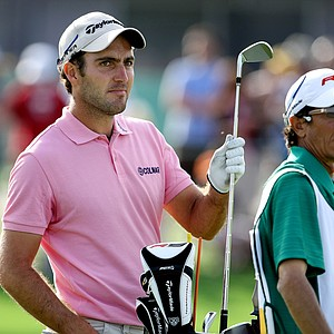 Edoardo Molinari checks the leaderboard before playing a shot on the final hole at Bay Hill.