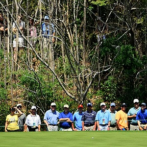 Ernie Els hits a putt at No. 2 green at Bay Hill Club.