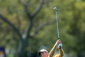 Jim Furyk hits his approach shot at the 18th.