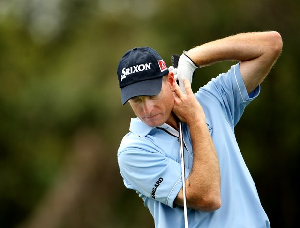 Jim Furyk looks down after his tee shot at No. 7.