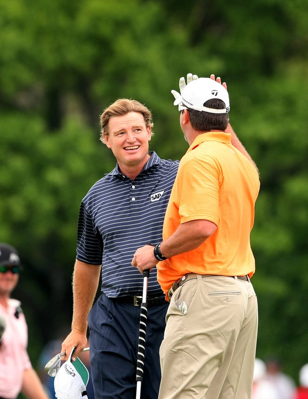 Ernie Els gets a high -five from Chris Couch after Els chipped in at No. 9.