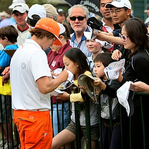 Rickie Fowler signs autographs after finishing his final round. Fowler shot a final round 73.