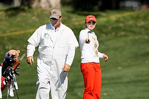 Candace Schepperle, right, with her father/caddie David during the first round. Schepperle is one of seven amateurs playing in the event.