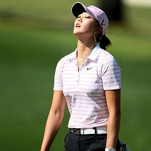 -Michelle Wie reacts to missing a birdie putt at No. 17.