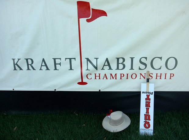 An abandoned QUIET paddle and hat near the grandstands at Hole No. 18.