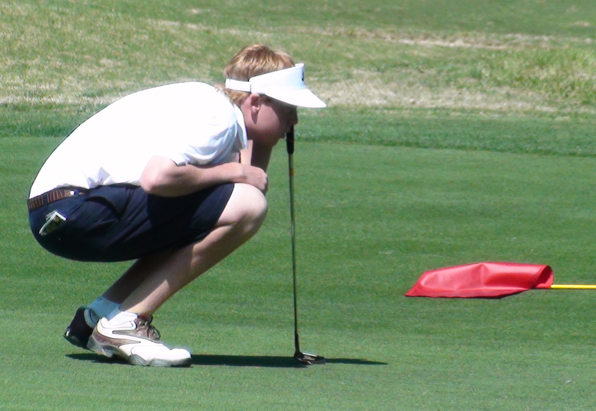 Dru Love reads a putt at the Palmetto High School Championship.
